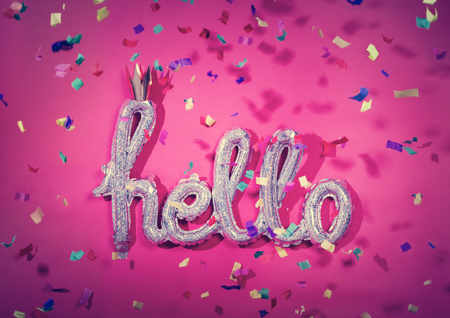 HELLO balloon and falling confetti. Party, birthday celebration. Colorful festive decoration.