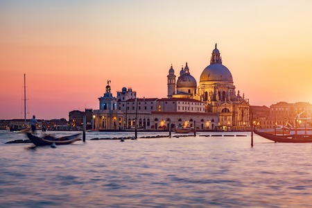 Venice, Italy at sunset. Santa Maria della Salute church. Popular travel destination. Summer.