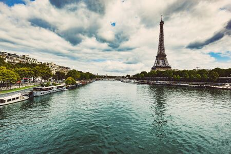 Eiffel Tower seen from Seine River in Paris, France. Capital cities of Europ. Travel destinations.