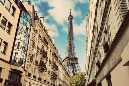 Eiffel Tower seen from the street of Paris, France. Summertime. Popular travel destination.