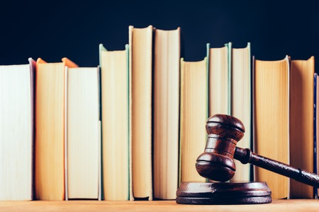 Court hammer and books on black background. Court chambers, office of judge. Law and trial. Stock Photo