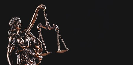 Themis, symbol of law, with measuring scale on black background. Greek goddess of justice and order. Stock Photo