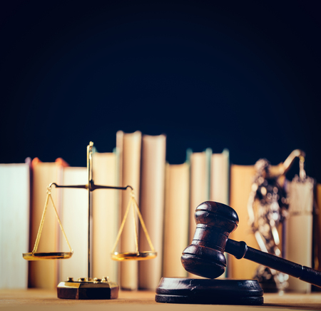 Symbols of law - scale, hammer and Themis statue in the office. Law and legal system symbols. Judgment. Stock Photo