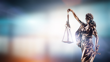 Themis, symbol of law on modern background. Court, legal system and justice. Stock Photo