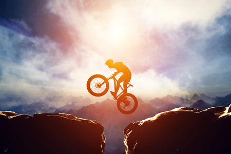 Man jumping with bike between two high mountains at sunset. Concept of taking a risk, extreme sport, adventure. 3d illustration