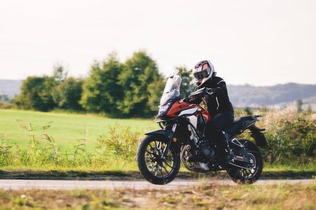 Drive a motorbike. Fast motorcycle in motion on countryside asphalt road.