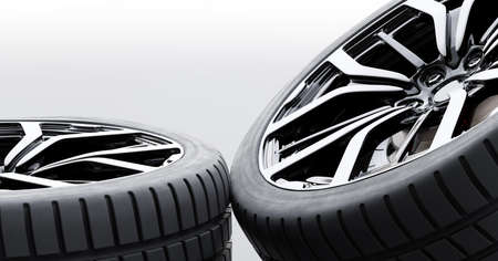 Wheels with modern alu rims on white background, close-up - banner composition. 3D illustration
