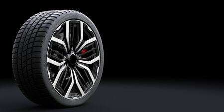 Wheel with modern alloy rim on black background - banner composition. 3D illustration Stock Photo