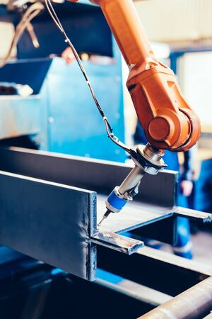 Robotic arm in a factory at work. Modern heavy industry, technology and machine learning Reklamní fotografie