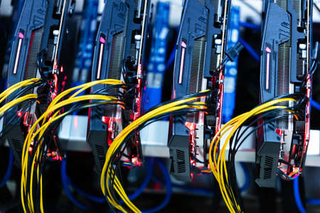 Bitcoin and cryptocurrency miner - a mining computer. Close-up on several GPU
