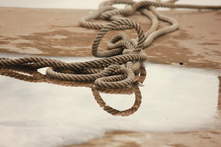 inedible: shadow rope in water Stock Photo