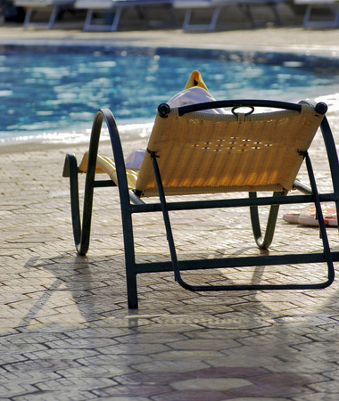 sunbeds: Beautiful yellow sunbed, outdoor, swimming pool Stock Photo