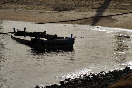 sunken boat: Beautiful old sunken boat, sea, sand, stones