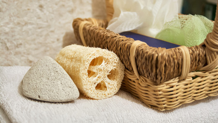 Beautiful view of spa accessories, basket and white towel
