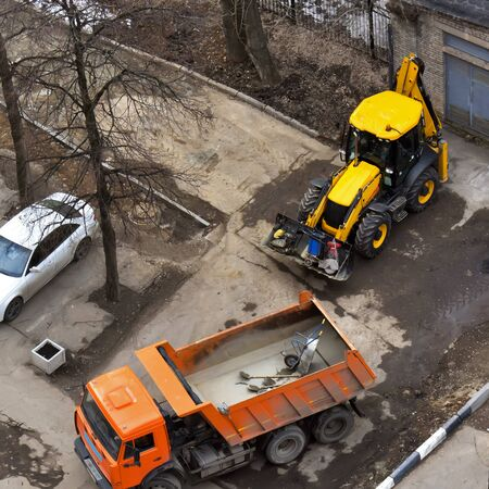 dump truck: View of working dump truck and tractor