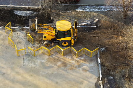 View of working dump truck and tractor photo