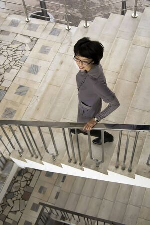go inside: Woman is walking on the stairs, sunlight