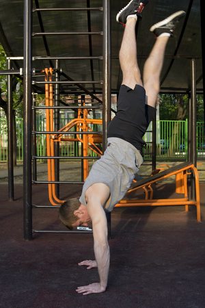 muscularity: View of a man hand standing and training outside