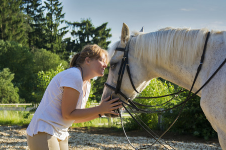 horse love horse kiss animal love: Beautiful view of a woman and a horse, close view Stock Photo