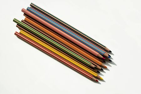 tied together: Colorful pencils, tied together, different colors Stock Photo