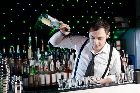 mixing: Bartender bartender is pouring a drink Stock Photo