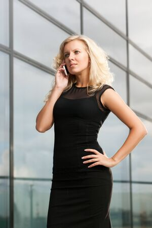 Attractive business lady on the phone photo