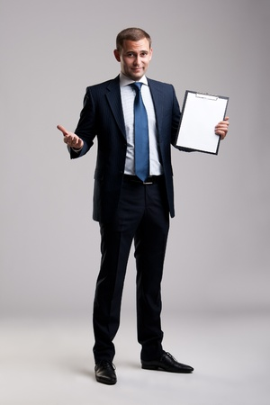 Young and successful businessman holding a clipboard photo