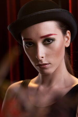portrait of attractive female in bowler hat photo