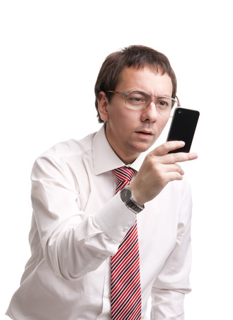 Nerdy businessman holding a smartphone and trying to read a message photo