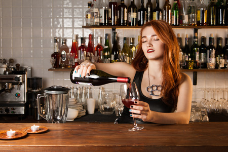 Sexy redhead bartender photo