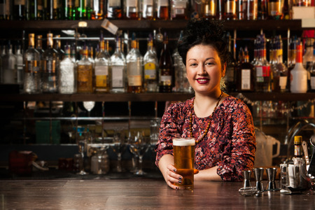 bar counters: Bartender with beer Stock Photo