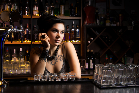 waitresses: Attractive bartender with drinks Stock Photo