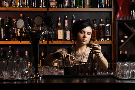 Attractive bartender with cocktail Stock Photo