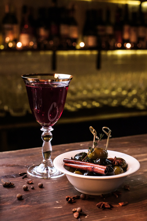 vine: Olives and red Wine