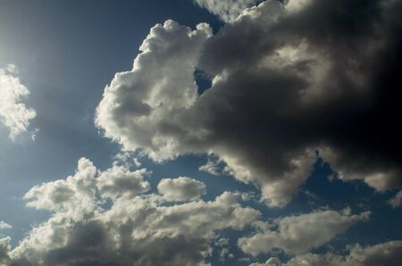 Cumulus clouds float away to the right, as if under the pressure of the luminous flux of the sun.