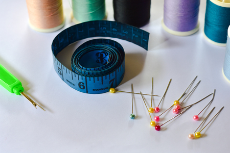 Sewing equipment has a white background, sewing needle. Design
