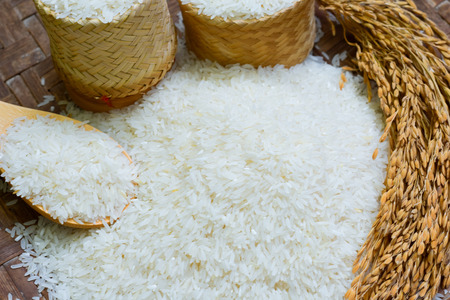 jasmine rice, Rice in Wooden Bowl, basmati rice, rice is on  wooden floor as the background.