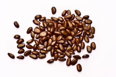 Heap of custard apple seeds isolated on white background Stock Photo