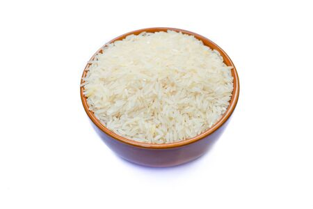 Rice is in a bowl of white background. Banco de Imagens