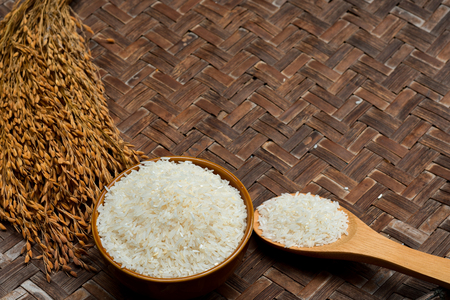 jasmine rice, Rice in Wooden Bowl, basmati rice, rice is on wooden floor as background. Banco de Imagens