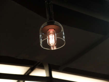 edison: An incandescent light in a modern lampshade Stock Photo