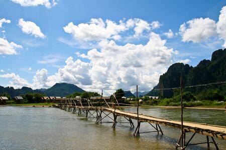 The wooden bridge  in Lao Stock Photo - 16669651