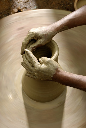 potters wheel: Indian potter making a pot at the potters wheel