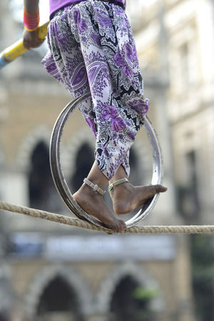 anklet: Acrobatic girl walking on rope with the help of wheel and pole ,near Jahngir Art Gallery Mumbai bombay