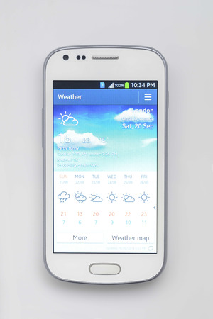 ringtones: White Smartphone Showing Weather at London Stock Photo