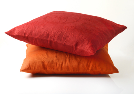 cushioning: Red And Yellow Pillow on White Background