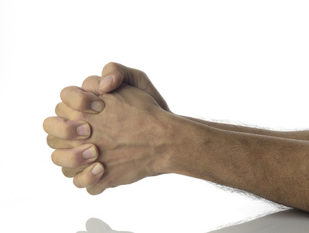 unknown age: High resolution image of human hands showing anxiety ,tension,fear and stress,shot in studio on white background. Stock Photo