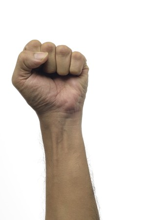 punched out: High resolution image of human fist against white background