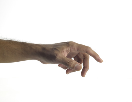 unknown age: High resolution image of human hand holding virtual computer mouse shot in studio over white background