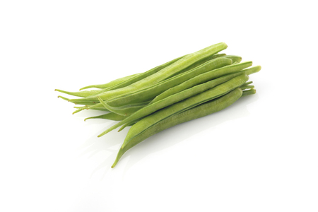 High resolution image of fresh green cluster beans on white background shot in studio.